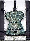NZ1220 : Sign for the Wheatsheaf by Maigheach-gheal