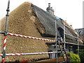 TL0654 : Roof repairs at Ravensden by M J Richardson