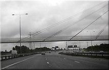 SJ8092 : M60 passing under footbridge by Sale Water Park by Peter Bond