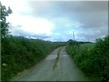 SW9445 : Road to Higher Barwick Farm by Alex McGregor