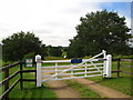 TM2548 : Gate to the caravan site near Seckford Hall by Chris Holifield
