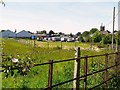 NY2548 : View across fields to the Auction Mart by Rose and Trev Clough