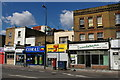 TQ3176 : Shops and launderette on Brixton Road by Christopher Hilton