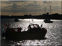 SZ1891 : Mudeford: silhouetted boats by Chris Downer