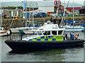 NS2975 : Police Patrol by Andy Farrington