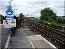 TQ2775 : Warning signs, Clapham Junction Station by Christine Johnstone