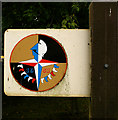 TL0558 : Festival of Britain logo, Thurleigh village sign by Julian Osley