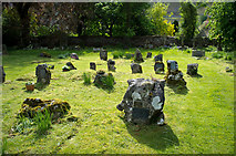 SD9772 : Grave stones, St Mary's Church, Kettlewell by Rob Burke