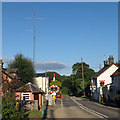 TM1136 : Level crossing and radio mast by Roger Jones
