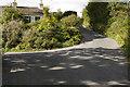 SD3286 : Road and lane junction Burn Knott by Tom Richardson