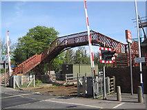 NZ1164 : Footbridge at Wylam Railway Station by Les Hull