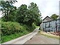 SO3078 : Lane snaking past farm buildings by Christine Johnstone