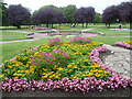 TQ1376 : Flower beds in Lampton Park by Marathon