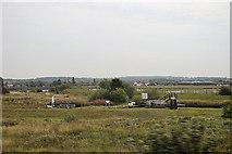 SE3118 : Thorne's Flood Lock from railway line by John Firth