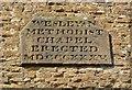 SP7866 : Datestone on the Village Theatre, Moulton by Humphrey Bolton
