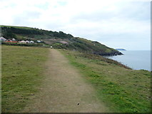SN4562 : Walker on the Ceredigion Coast Path out of Aberaeron by Jeremy Bolwell