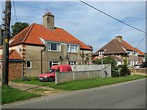 TF6830 : Cottages in Station Road, Dersingham by Evelyn Simak