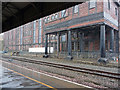 SE1416 : Warehouse adjacent to Huddersfield railway station by Phil Champion