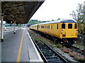 ST5972 : Weeds and yellow carriages, Bristol Temple Meads by Jaggery