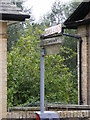 TM2858 : Roadsign to the Cemetery & Bowls Club by Adrian Cable