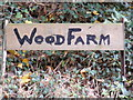 TM3568 : Wood Farm sign by Adrian Cable