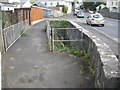 SX8477 : Plymouth Road and a footpath cross a brook by Robin Stott