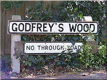 TM2750 : Godfreys Wood sign by Adrian Cable