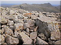 NY2207 : Rocky foreground to Esk Pike and Bowfell by Peter S