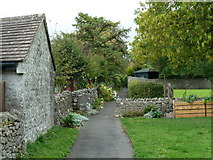 SK1971 : Village footpath, Great Longstone by Andrew Hill