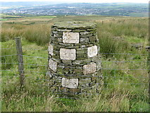 SD8428 : Burnley:  Decorated cairn near Crown Point by Dr Neil Clifton