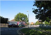 SK8508 : A train at Brooke Road level crossing by Andrew Tatlow