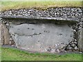 O0072 : Carved stone in the rear outer wall of the Newgrange Tomb by Eric Jones