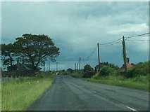 N6775 : Gate and gatehouse on the R163 at Ballynagon Lower by Eric Jones
