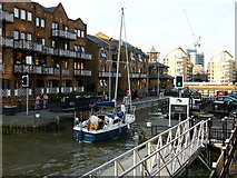 TQ3680 : Yacht entering Limehouse Basin by Richard Durley