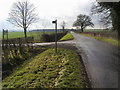 TL1074 : The road down to the A14 at the footpath to Saltwells by Shaun Ferguson