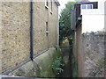 TQ3168 : Norbury Brook: looking downstream at Quadrant Road by Christopher Hilton