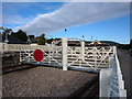 NH8912 : Level crossing gates at Aviemore station by Phil Champion