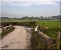 SD4481 : Bridge over a drainage ditch on the Cumbria Coastal Way by Ian Greig