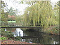 SJ6869 : Ornamental lake and bridge in the grounds of Whatcroft Hall by Dr Duncan Pepper