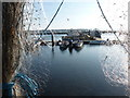 SZ0190 : Poole: marina view through fishing nets by Chris Downer