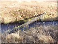 NR3653 : Pipe across the Torra River, Islay by Becky Williamson