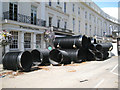 SP3165 : Plastic sewer pipes awaiting placement, Parade by Robin Stott