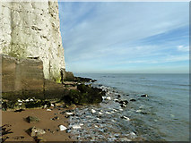 TR4068 : Cliff at north end of Stone Bay by Robin Webster
