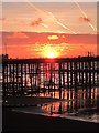 TQ8108 : Sunrise over Hastings Pier by Oast House Archive