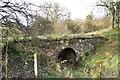 NS4275 : Old stone bridge near Overtoun House by Lairich Rig