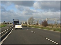 SK0419 : Rugeley bypass alongside the West Coast main railway line by Peter Whatley