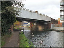 TQ1883 : Bridge 11A, Piccadilly Line over Paddington Branch, Grand Union Canal by David Hawgood