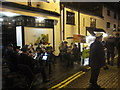 SJ9077 : Prestbury Christmas Street Party = ii by Peter Turner