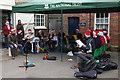TQ2668 : Festive ukulele band, Morden Hall Park, December afternoon by Christopher Hilton