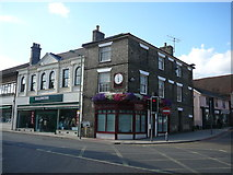 TM0458 : Shop at junction of Bury Street and Tavern Street, Stowmarket by Colin Park